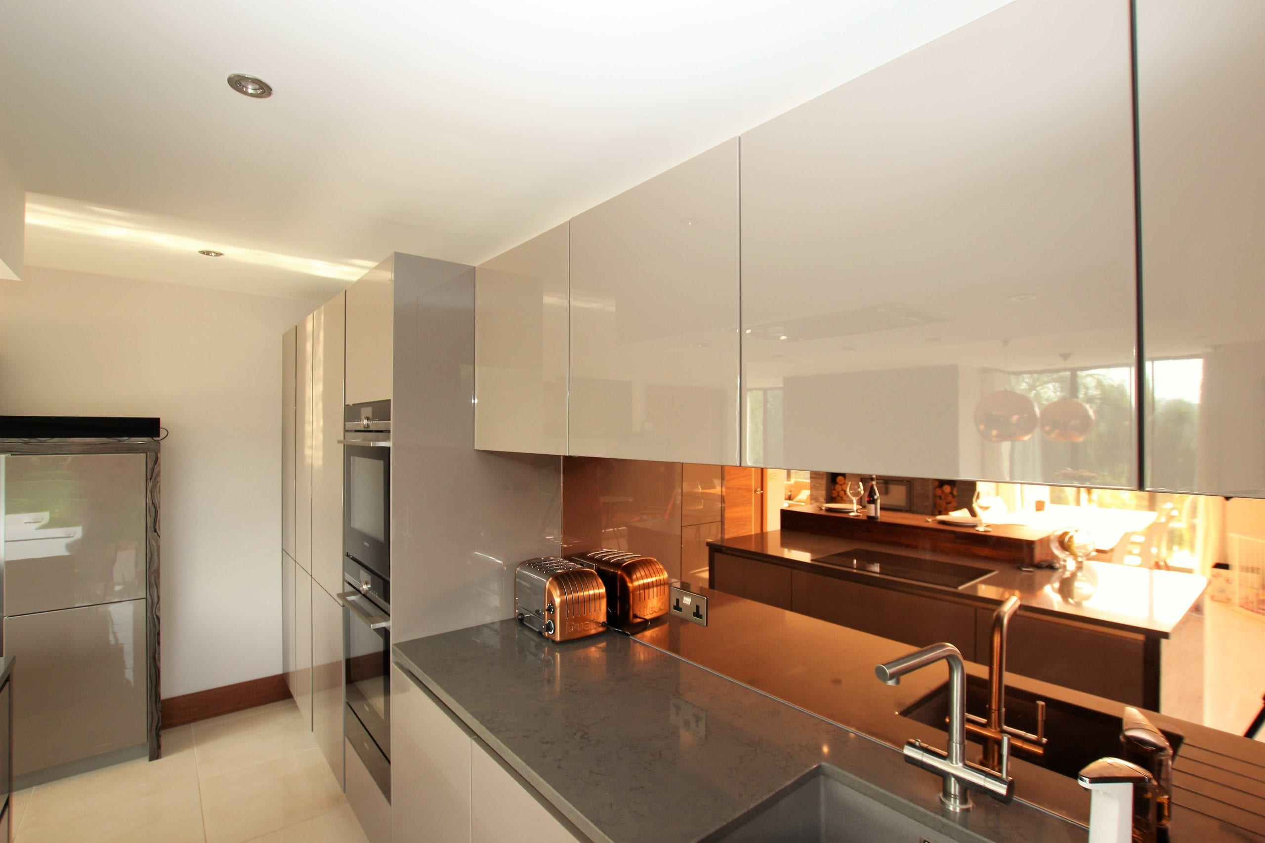16. Bronze mirror splashback scaled - Kavanagh Designs, Worthing