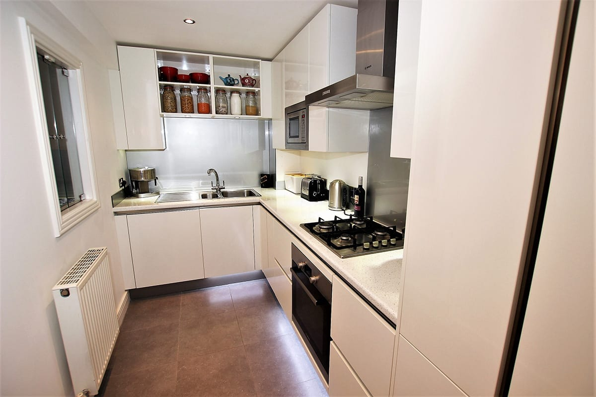 2. Small white kitchen layout Copy - Kavanagh Designs, Worthing